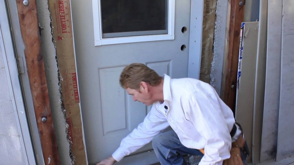 Installing a door and stucco lath tips