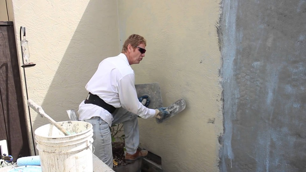 Re-coat a painted wall with new stucco, complete resurfacing